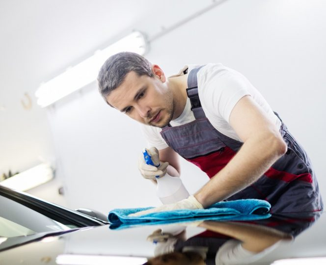 Polishing car with spray and microfibre cloth